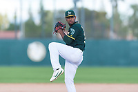 Oakland Athletics relief pitcher Leudeny Pineda (59) delivers a pitch during an exhibition game against Team Italy at Lew Wolff Training Complex on October 3, 2018 in Mesa, Arizona. (Zachary Lucy/Four Seam Images)
