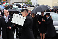 "COPY BY TOM BEDFORD<br /> Pictured: Paul Black kisses the white coffin of his daughter Pearl as he carries it to the Jerusalem Baptist Chapel in Merthyr Tydfil, Wales, UK. Friday 18 August 2017<br /> Re: The funeral of a toddler who died after a parked Range Rover's brakes failed and it hit a garden wall which fell on top of her will be held today at Jerusalem Baptist Chapel in Merthyr Tydfil.<br /> One year old Pearl Melody Black and her eight-month-old brother were taken to hospital after the incident in south Wales.<br /> Pearl's family, father Paul who is The Voice contestant and mum Gemma have said she was ""as bright as the stars""."