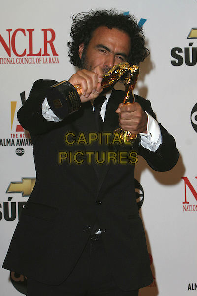 ALEJANDRO GONZALEZ INARRITU.2007 NCLR ALMA Awards - Press Room held at the Pasadena Civic Center, Pasadena, California, USA..June 1st, 2007.half length black suit award trophy jacket awards trophies .CAP/ADM/CH.©Charles Harris/AdMedia/Capital Pictures *** Local Caption *** .