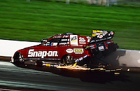 Sept. 1, 2012; Claremont, IN, USA: NHRA funny car driver Cruz Pedregon hits the wall during qualifying for the US Nationals at Lucas Oil Raceway. Mandatory Credit: Mark J. Rebilas-