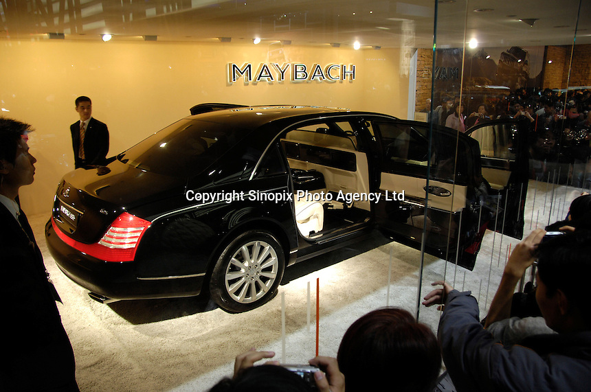 Visitors view a Maybach 62 S at the 2006 International Automotive Exhibition in Beijing, China..25 Nov 2006