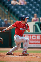 Lakewood BlueClaws center fielder Kevin Markham (30) follows through on a swing during a game against the Greensboro Grasshoppers on June 10, 2018 at First National Bank Field in Greensboro, North Carolina.  Lakewood defeated Greensboro 2-0.  (Mike Janes/Four Seam Images)