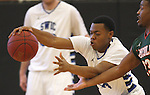 Lincoln Trail College player Dennis Hightower (23, right) and Southwestern College player Vashawn Ruffin (24, left) both grab for the ball in the first half.