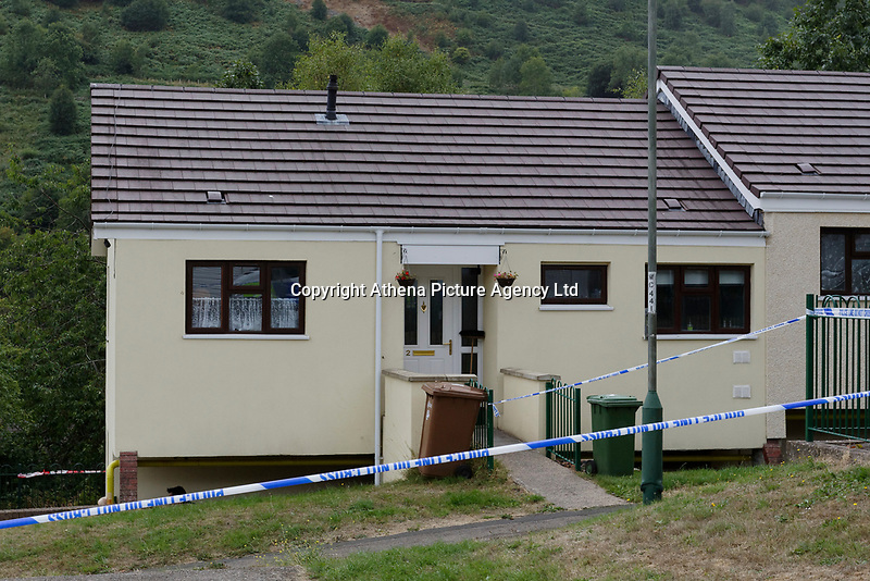 Pictured: The house where the body of David Gaut was discovered in New Tredegar, Wales, UK. Wednesday 08 August 2018<br /> Re: Three men have been arrested after a man was found dead at a house in New Tredegar, Wales, UK.<br /> David Gaut, 54, was found in Long Row, in the Elliots Town area of New Tredegar, on Saturday, August 4.<br /> Two two-storey terraced homes, owned by Caerphilly council, have been cordoned off and police officers are patrolling the area. <br /> David Gaut was jailed for life in July 1985 when he was 21 years old, for the murder and torture of17-month old Chi Ming Shek