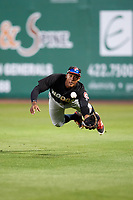 Chattanooga Lookouts right fielder Edgar Corcino (11) dives to try to make a catch during a game against the Jackson Generals on April 27, 2017 at The Ballpark at Jackson in Jackson, Tennessee.  Chattanooga defeated Jackson 5-4.  (Mike Janes/Four Seam Images)