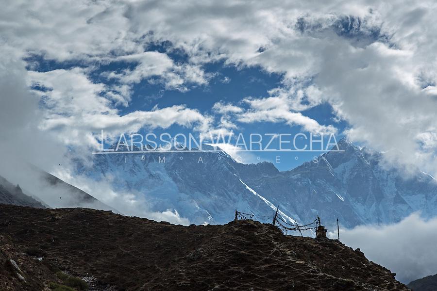 Mani stones, stupas and Everest, Lhotse, Nuptse in the background.