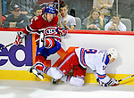 23 January 2010: Montreal Canadiens left wing forward Mathieu Darche is upended by New York Rangers defenseman Marc Staal in the third period at the Bell Centre in Montreal, Quebec, Canada. The Canadiens shut out the Rangers 6-0. Mandatory Credit: Ed Wolfstein Photo