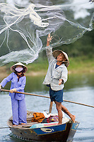 A fisherman casts his net on the Thu Bon River near Hoi An IV.