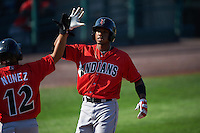 Indianapolis Indians outfielder Keon Broxton (24) is congratulated by Gustavo Nunez (12) after hitting a two run home run during a game against the Rochester Red Wings on June 10, 2015 at Frontier Field in Rochester, New York.  Indianapolis defeated Rochester 5-3.  (Mike Janes/Four Seam Images)