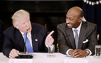United States President Donald Trump (C) speaks as Kenneth Frazier Chairman and CEO, of Merck   looks on during a  listening session with manufacturing CEOs  in the State Dining Room  of the White House on February 23, 2017 in Washington, DC.<br /> Credit: Olivier Douliery / Pool via CNP