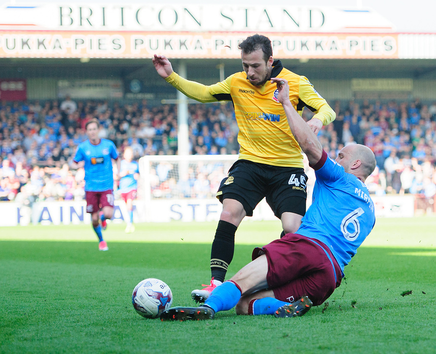 Bolton Wanderers&rsquo; Adam Le Fondre is tackled by Scunthorpe United's David Mirfin<br /> <br /> Photographer Chris Vaughan/CameraSport<br /> <br /> The EFL Sky Bet League One - Scunthorpe United v Bolton Wanderers - Saturday 8th April 2017 - Glanford Park - Scunthorpe<br /> <br /> World Copyright &copy; 2017 CameraSport. All rights reserved. 43 Linden Ave. Countesthorpe. Leicester. England. LE8 5PG - Tel: +44 (0) 116 277 4147 - admin@camerasport.com - www.camerasport.com