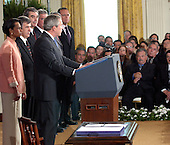 Washington, D.C. - August 2, 2005 --  United States President George W. Bush signs the Central America Free Trade Agreement (CAFTA) during a ceremony in the East Room of the White House in Washington, D.C. on August 2, 2005.  The agreement, between the United States and Costa Rica, El Salvador, Guatemala, Honduras, Nicaragua and the Dominican Republic, removes trade barriers and opens up the region to American goods and services. It also moves to facilitate investment in the area and strengthens protections for intellectual property.  It barely passed the House of Representatives by a 217 to 215 vote.<br /> Credit: Ron Sachs / CNP