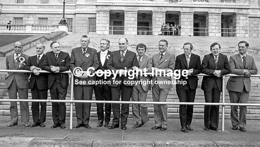 United Ulster Unionist Council, UUUC, candidates, in the October 1974 UK General Election pose for a group photograph in front of Stormont Buildings, Belfast, N Ireland. From left: Johnny McQuade, James Molyneaux, Enoch Powell, Rev Ian Paisley, James Kilfedder, Harry West, John Carson, William Craig, Rev Robert Bradford, Harold McCusker and William Ross. They were united in their opposition to the Sunningdale Agreement. Their grouping captured 11 of the 12 Northern Ireland seats. 197410000570b<br />