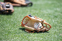 A California League baseball rests inside a glove before a game between the Lancaster JetHawks and San Jose Giants at San Jose Municipal Stadium on May 13, 2018 in San Jose, California. San Jose defeated Lancaster 3-0. (Zachary Lucy/Four Seam Images)