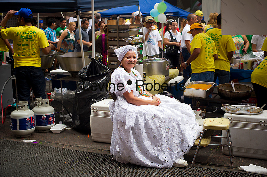 A food vendor at the 28th Annual Brazil Day Festival in New York on Sunday, September 2, 2012.  The festival, which features food, music and other aspects of Brazilian culture, centers around West 46th Street in Midtown Manhattan, known as Little Brazil. (© Frances M. Roberts)