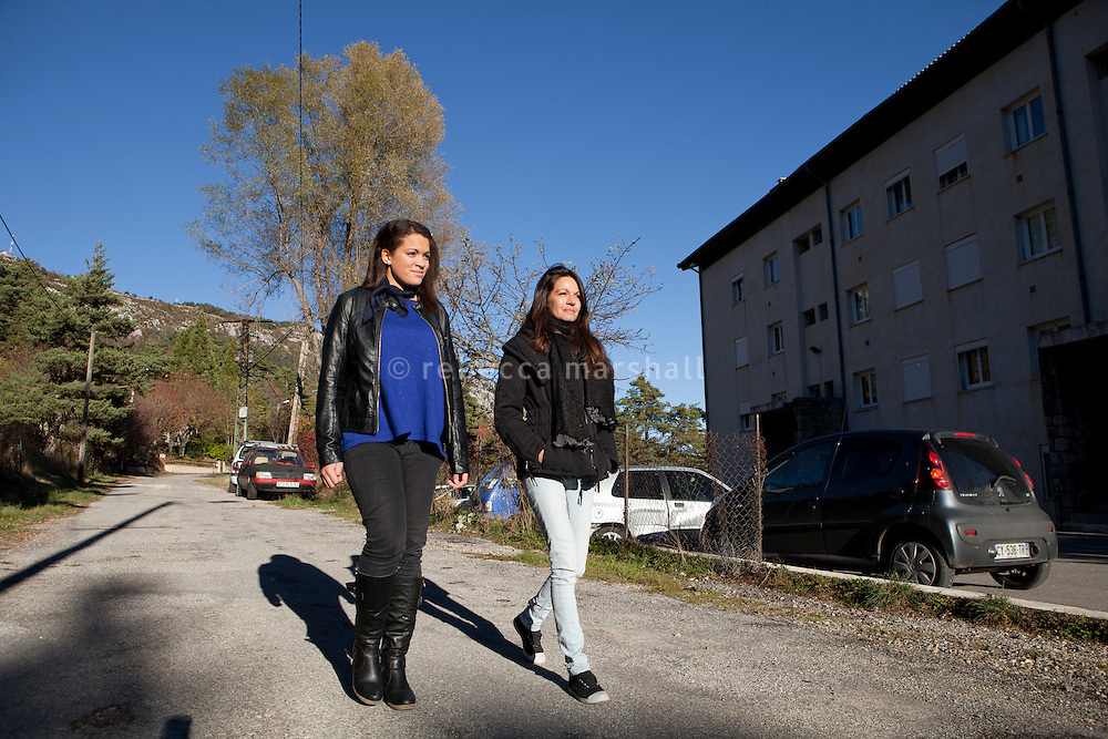 Manon Serrano (left) and her mother Sophie walk together down the road on which their apartment block is situated (right in picture), Thorenc, Alpes-Maritimes, France, 11 November 2013