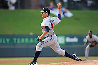 Pitcher Rafael Briceno (48) of the Rome Braves in a game against the Greenville Drive on Tuesday, August 20, 2013, at Fluor Field at the West End in Greenville, South Carolina. Rome won, 4-2. (Tom Priddy/Four Seam Images)