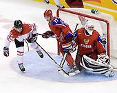 Chris Di Domenico (Canada - 25), Maxim Chudinov (Russia - 27), Vadim Zhelobnyuk (Russia - 1) - Canada defeated Russia 6-5 on Saturday, January 3, 2009, at Scotiabank Place in Kanata (Ottawa), Ontario during the 2009 World Junior Championship.