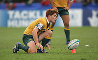 Australian scrum half Jason Ryan gets set for a kick at goal during the clash 3rd/4th place clash at Ravenhill, Belfast. Result Australia 25 Wales 21.