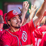 31 May 2014: Washington Nationals infielder Anthony Rendon smiles in the dugout after scoring on a Jayson Werth RBI double in the second inning against the Texas Rangers at Nationals Park in Washington, DC. The Nationals defeated the Rangers 10-2 to notch their second win of the 3-game inter-league series. Mandatory Credit: Ed Wolfstein Photo *** RAW (NEF) Image File Available ***
