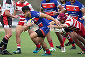 Jonathan Taumateine tries to break free from Scott Uren's clutches. Counties Manukau Premier Club Rugby Semi-final game between Ardmore Marist and Karaka, played at Bruce Pulman Park Papakura, on Saturday July 14th 2018.<br /> Ardmore Marist won the game 53 - 8 after leading 22 - 3 at halftime. <br /> Photo by Richard Spranger.