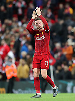2nd January 2020; Anfield, Liverpool, Merseyside, England; English Premier League Football, Liverpool versus Sheffield United; Jordan Henderson of Liverpool returns the applause from supporters on the Kop after the final whistle - Strictly Editorial Use Only. No use with unauthorized audio, video, data, fixture lists, club/league logos or 'live' services. Online in-match use limited to 120 images, no video emulation. No use in betting, games or single club/league/player publications
