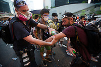 Photojournalists wash off pepper spray and tear gas in front of the Hong Kong government headquarters in Hong Kong's downtown district, on the first day of the mass civil disobedience campaign Occupy Central, Hong Kong, China, 28 September 2014.