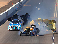 Feb 25, 2018; Chandler, AZ, USA; NHRA funny car driver John Force (right) goes across track after explodes the body off his car on fire in front of Jonnie Lindberg during the Arizona Nationals at Wild Horse Pass Motorsports Park. Mandatory Credit: Mark J. Rebilas-USA TODAY Sports