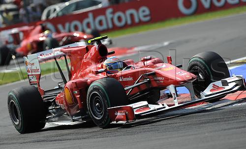 Spanish driver Fernando Alonso of Ferrari drives ahead of his Brazilian teammate Felipe Massa during the 2010 Formula One Italian Grand Prix at the Autodromo Nazionale in Monza, Italy.