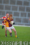 Duaghs Declan Griffin spins past Adrigoles John OShea in their Munster Junior Club Football final.in Fitzgerald Stadium.