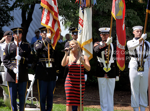 Bethesda, MD - July 1, 2009 -- Jessica Simpson sings the National Anthem during the opening ceremony for the AT&T National Hosted by Tiger Woods at Congressional Country Club in Bethesda, Maryland on Wednesday, July 1, 2009..Credit: Ron Sachs / CNP
