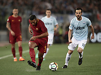 Calcio, Serie A: S.S. Lazio - A.S. Roma, stadio Olimpico, Roma, 15 aprile 2018. <br /> Roma's Juan Jesus (l) in action with Lazio's Marco Parolo (r) during the Italian Serie A football match between S.S. Lazio and A.S. Roma at Rome's Olympic stadium, Rome on April 15, 2018.<br /> UPDATE IMAGES PRESS/Isabella Bonotto
