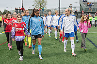 Allston, MA - Saturday, May 07, 2016: Chicago Red Stars forward Christen Press (23) and Boston Breakers defender Whitney Engen (4) lead their teams onto the field prior a regular season National Women's Soccer League (NWSL) match at Jordan Field.