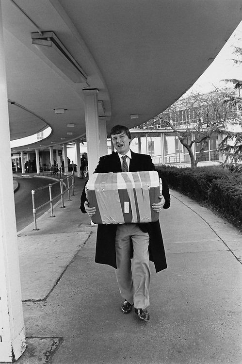 Rep. Jimmy Hayes, D-La. making his first trip to the terminal, loaded down with cooler full of papers, photos, and other stuff. When he returns to D.C., the cooler will be filled with shrimp. He arrived early for his flight to Baton Rouge, LA on November 27, 1991. (Photo by Maureen Keating/CQ Roll Call)