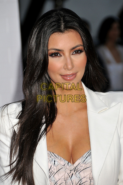 "KIM KARDASHIAN.""The Taking of Pelham 123"" Los Angeles Premiere held at Mann's Village Theatre, Westwood, CA, USA..June 4th, 2009.headshot portrait cleavage white pink black pattern.CAP/ADM/BP.©Byron Purvis/AdMedia/Capital Pictures."