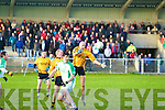Aiden Holly of Ballyduff comes under pressure from Emmet's Paudie Buckley and Tadgh Kennelly.
