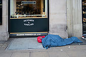 Sleeping place of a rough sleeper outside luxury shop, Piccadilly, London.