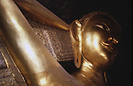 The great reclining Buddah relaxes in a temple in the Wat Po Temple Complex in in Bangkok, Thailand. (Jim Bryant Photo)....