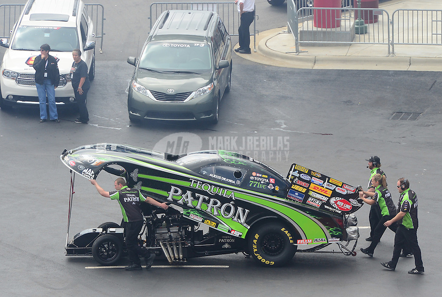 Apr. 15, 2012; Concord, NC, USA: NHRA crew members for funny car driver Alexis DeJoria during the Four Wide Nationals at zMax Dragway. Mandatory Credit: Mark J. Rebilas-