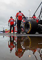 May 1, 2016; Baytown, TX, USA; The car oNHRA top fuel driver Doug Kalitta reflects in a rain puddle as crew members push it during the Spring Nationals at Royal Purple Raceway. Mandatory Credit: Mark J. Rebilas-USA TODAY Sports
