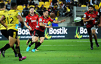 Mike Delaney passes during the Super Rugby match between the Hurricanes and Crusaders at Westpac Stadium in Wellington, New Zealand on Saturday, 10 March 2018. Photo: Dave Lintott / lintottphoto.co.nz