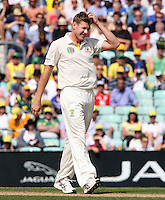James Faulkner of Australia - England vs Australia - 5th day of the 5th Investec Ashes Test match at The Kia Oval, London - 25/08/13 - MANDATORY CREDIT: Rob Newell/TGSPHOTO - Self billing applies where appropriate - 0845 094 6026 - contact@tgsphoto.co.uk - NO UNPAID USE