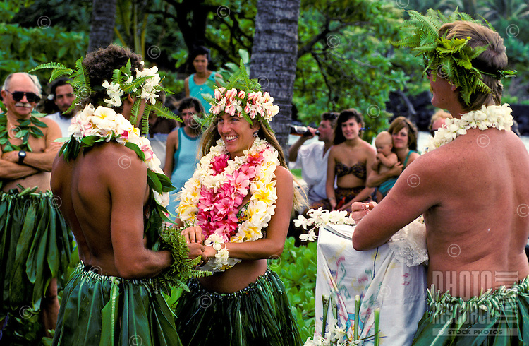 Wedding in traditional ti skirts and leis, Kapoho, Big Island of Hawaii