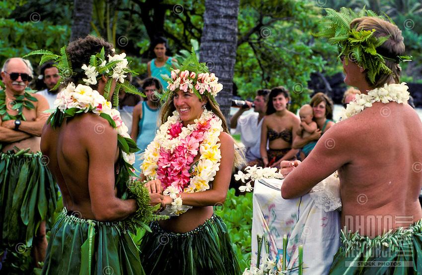 Wedding in traditional ti skirts and leis, Kapoho, Big Island of Hawaii