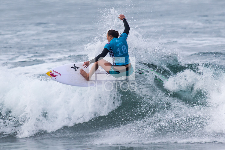 Huntington Beach, CA - Saturday August 4, 2018: Carissa Moore in action during a World Surf League (WSL) World Championship Tour (WCT) Round 3 heat at the 2018 Vans U.S. Open of Surfing on South side of the Huntington Beach pier.