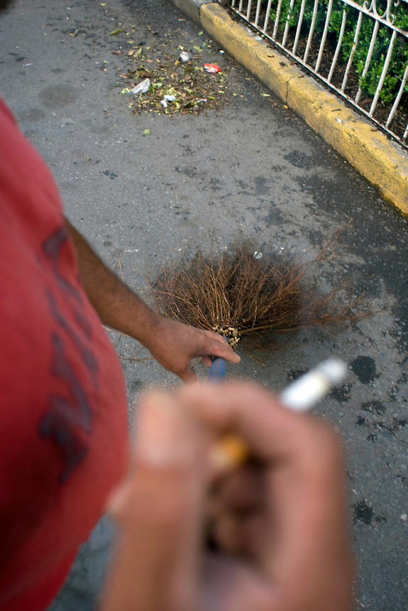 """Javier Hernandez Vilchis, works sweeping the streets as a """"freelancer"""" which means he earns no salary and recieves no benefits, he works everyday for tips in the wealthy Las Lomas neighbourhood of Mexico City 09-08-07"""