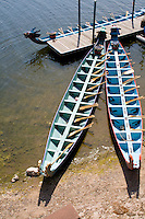 Three dragon race boats moored to dock. Dragon Festival Lake Phalen Park St Paul Minnesota USA