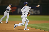OAKLAND, CA - MAY 30:  Matt Duffy #5 of the Tampa Bay Rays makes a play at third base against the Oakland Athletics during the game at the Oakland Coliseum on Wednesday, May 30, 2018 in Oakland, California. (Photo by Brad Mangin)