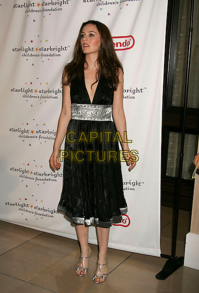 "ALICIA SILVERSTONE.The Starlight Starbright Children's Foundation holds ""A Stellar Night Gala"" - Arrivals at the Beverly Hilton Hotel, Beverly Hills, California, USA..March 31st, 2006.Photo: Russ Elliot/AdMedia/Capital Pictures.Ref: RE/ADM.full length black dress silver detail.www.capitalpictures.com.sales@capitalpictures.com.© Capital Pictures."