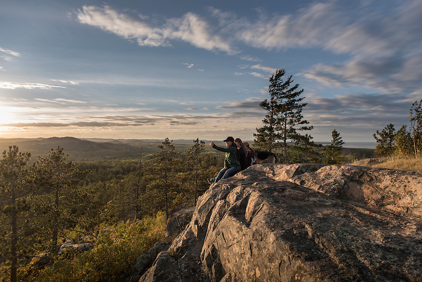 Northern Michigan University Students enjoy a sunset atop Sugarloaf Mountain near Marquette, Michigan.